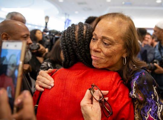 Lonnie Ali, widow of Muhammad Ali, hugs a friend following the unveiling of the Louisville Muhammad Ali International Airport logo. June 6, 2019.