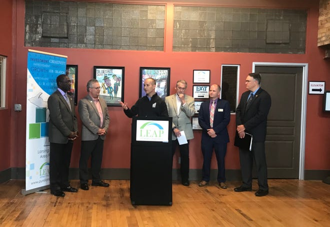 Lansing Mayor Andy Schor speaks at a press conference announcing a $600,000 grant from the Environmental Protection Agency that will help cover environmental assessments on brownfield sites.