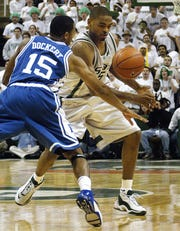 MSU's Alan Anderson tries to get around Duke's Sean Dockery during the Blue Devils' last visit to East Lansing, a lopsided Duke win in 2003.