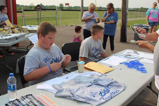 Gavin Conley, 11, helps raise money for his football coach Ron Johnson who was diagnosed with ALS in October. Conley helped plan a walk to raise awareness on the last day of May, which is ALS awareness month.