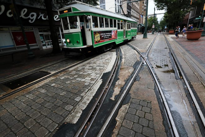 A trolley car makes its way through Main Street downtown on Thursday, June 6, 2019.