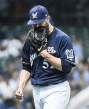 Brewers pitcher Jimmy Nelson walks off the mound Wednesday night after giving up five runs (four earned) in three innings against the Marlins in his first game since a 2017 shoulder injury.
