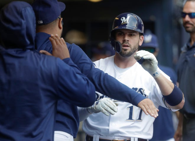 Mike Moustakas is congratulated after hitting a home run.