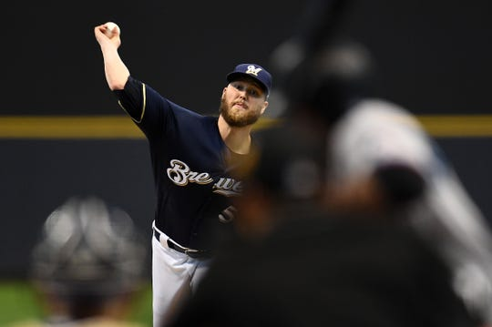 Jimmy Nelson of the Brewers pitches to his first batter in a big league game since Sept. 8, 2017, when he blew out his pitching shoulder diving back to first base in a game against the Cubs at Wrigley Field.