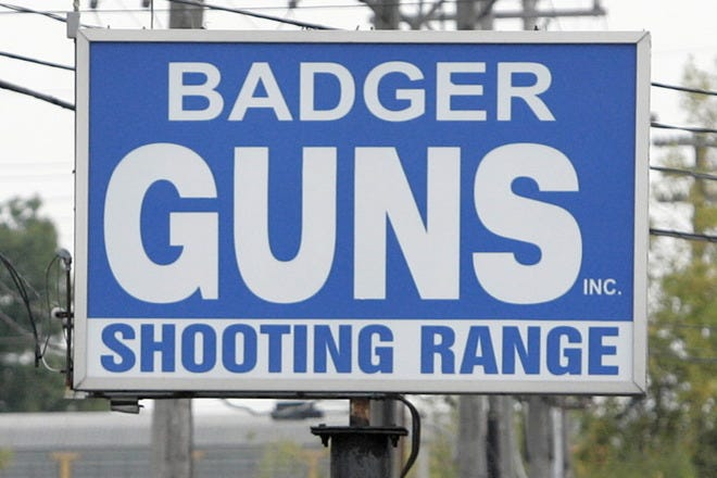 Owners of Badger Guns posted a sign in front of their store in protest of Milwaukee police stopping their customers leaving the store, Thursday, September 24, 2009.  Milwaukee police are checking whether people are buying guns legally.