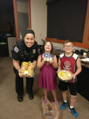 The Oconomowoc Police Department received food and gift packages from thankful citizens after a 12-hour police standoff. Officer Molly Nitka (left) posed with Amanda Pinsch and Ryan Pinsch.