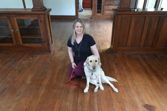 Michelle Steiner and service dog Isadora  relax for a moment inside what will become the Mountain Home satellite office of Grandma's House Children's Advocacy Center. The former residence at 914 South Main Street will be transformed over the coming months to serve as a safe environment for children who've suffered profound violence to be interviewed about their experiences.