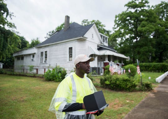 K'vaughn Dildy of Paleowest Archeology surveys homes and historical sites in Montgomery, Ala., on Thursday.
