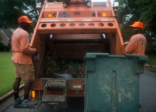 Sanitation crews collect yard waste in the Fox Hollow neighborhood in Montgomery, Ala., on Wednesday, June 5, 2019.