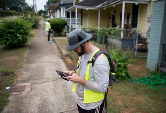 Clayton Barnes of Paleowest Archeology surveys homes and historical sites in Montgomery, Ala., on Thursday, June 6, 2019.
