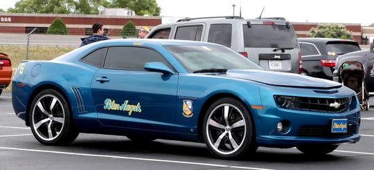 "Brian Wright of the Walter Hill area brought his decorated 2010 Camaro to honor the Blue Angels pilot, USMC Captain Jeff ""Kooch"" Kuss who crashed in Smyrna in 2016, to the Smyrna Event Center to watch the U.S.Navy Flight Demonstration team the Blue Angels, practice, on Thursday, June 6, 2019, over the Smyrna Airport."
