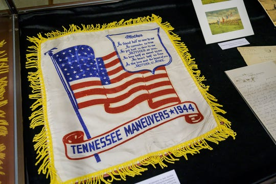 Artifacts from the Gore Center at MTSU such as include ration stamps, medals, wartime sheet music, are featured in an exhibit detailing Tennessee's ties to D-Day.