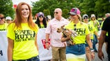 Miranda Lambert leads the MuttNation March to kick off CMA Fest on Thursday morning. Lambert started the foundation to help shelter dogs.