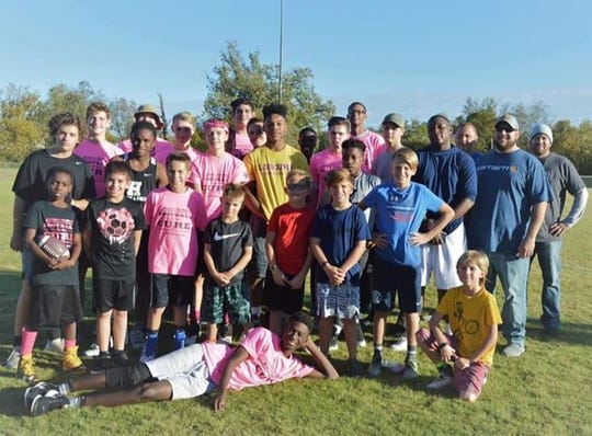 Participants in last year's Football for the Cure event pose for a photo.
