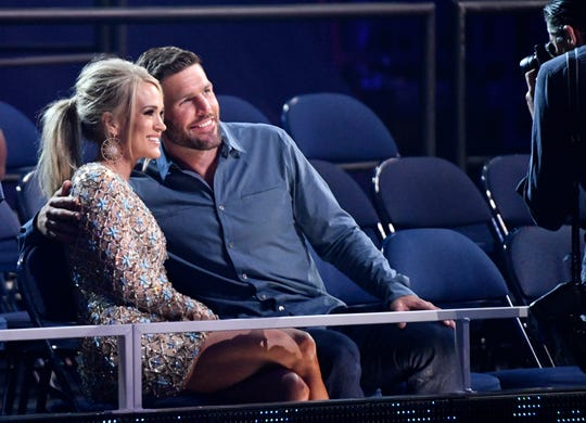 Carrie Underwood and husband Mike Fisher pose for a photo before the CMT Music Awards in June. Fisher and their two sons, ages 4 and 8 months, go on the road with Underwood.
