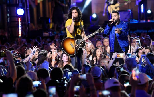 Dan + Shay perform on Lower Broadway during the 2019 CMT Music Awards at Bridgestone Arena Wednesday, June 5, 2019, in Nashville, Tenn.