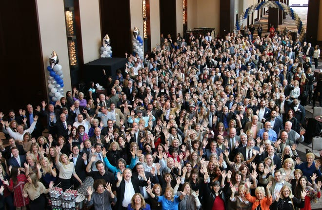A large group of Parks Realty employees gathered at the company's annual meeting.