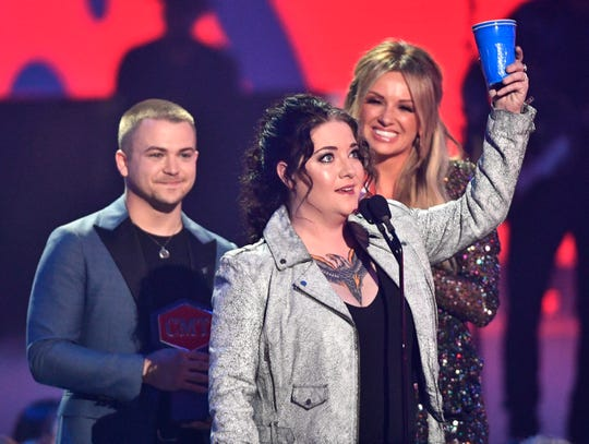 Ashley McBryde celebrates her win for Breakthrough Video of the Year presented by Hunter Hayes and Carly Pearce during the 2019 CMT Music Awards at Bridgestone Arena Wednesday, June 5, 2019, in Nashville, Tenn.