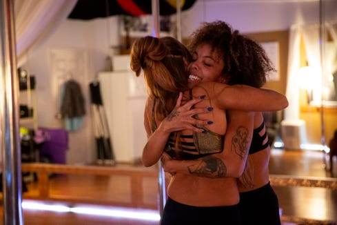 """Liz Strong, left, hugs instructor Danielle Hicks, who uses the name """"Kushina the Ninja"""" professionally, at Pole & Aerial Fitness of Southwest Florida in Bonita Springs on Saturday, May 18, 2019. Hicks's favorite part of teaching pole classes is the """"faces after class is over,"""" she said, """"cause you know I get women that are very timid and shy and they don't know what to expect and then afterwards they're like boss bitch queens... and that's a great feeling."""""""