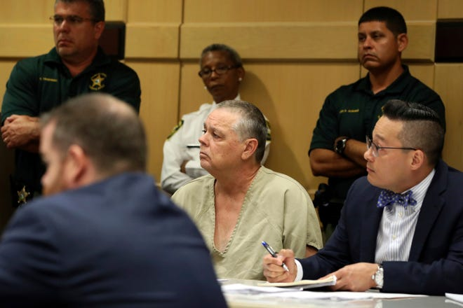 Former Broward Sheriff's Office deputy Scot Peterson and his defense attorney Joseph DiRuzzo appear in court during a hearing in Fort Lauderdale, Fla., Thursday, June 6, 2019. (Amy Beth Bennett/South Florida Sun-Sentinel via AP, Pool)