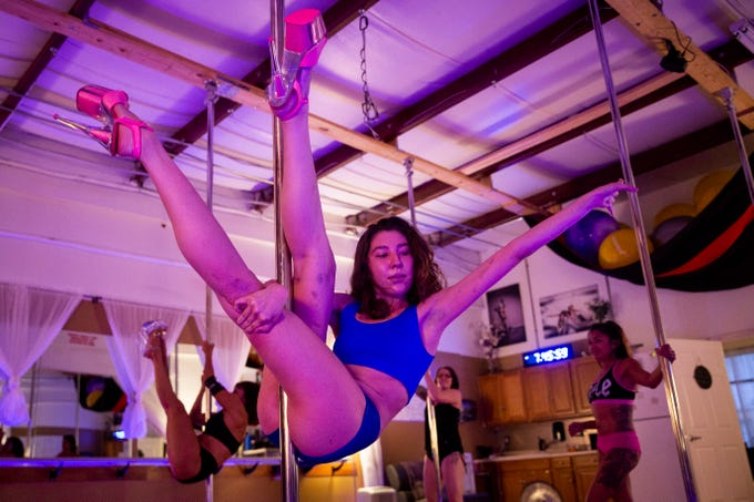 Katie Parra practices a pole trick at Pole & Aerial Fitness of Southwest Florida in Bonita Springs on Tuesday, May 14, 2019. The studio offers a variety of classes that cater to everyone, from those looking for a different kind of fitness option to those looking to express their more sensual side.