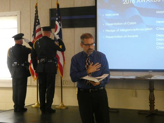 Chaplain Craig Burdick gives invocation at the 2019 Newark Division of Police Awards Presentation on Wednesday, May 29, 2019. Burdick is one of several chaplains who are part of the Licking County Prosecutor's Office Chaplain Division.