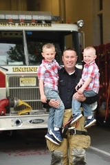 First Responder Father Daniel Keogh with his sons Dylan (age 5, L) and Ryan (age 2, R), at Schuyler Engine Company No.2 in North Arlington.