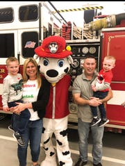 Dan Keogh pictured with his son Dylan, wife Lauren, and son Ryan at a North Arlington firehouse event.