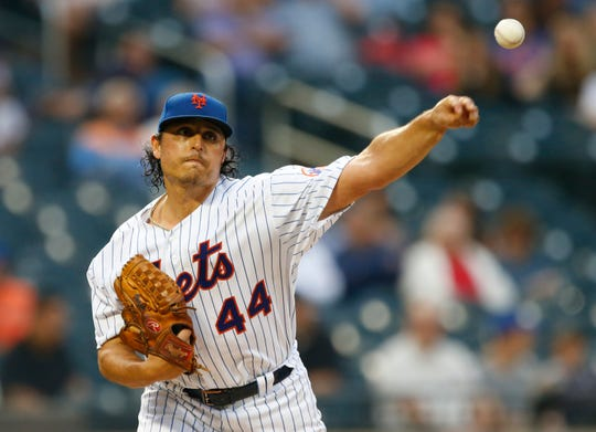 Jun 5, 2019; New York City, NY, USA;  New York Mets starting pitcher Jason Vargas (44) makes a throw to first base during game against the San Francisco Giants at Citi Field.