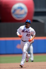 New York Mets' Dominic Smith runs the bases after hitting a solo home run off San Francisco Giants starting pitcher Shaun Anderson during the first inning of a baseball game, Thursday, June 6, 2019, in New York. (AP Photo/Julio Cortez)