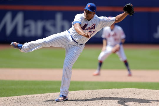 New York Mets relief pitcher Jeurys Familia strikes out San Francisco Giants' Stephen Vogt for the final out in a baseball game, Thursday, June 6, 2019, in New York. The Mets won 7-3. (AP Photo/Julio Cortez)