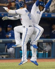 Toronto Blue Jays' Randal Grichuk celebrates with Vladimir Guerrero Jr. after Grichuk hit a two-run home run against the New York Yankees during the first inning of a baseball game Wednesday, June 5, 2019, in Toronto.