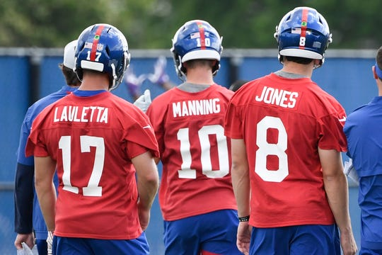 New York Giants quarterbacks Kyle Lauletta (17), Eli Manning (10), and Daniel Jones (8) work out on Day 3 of Giants minicamp on Thursday, June 6, 2019, in East Rutherford.
