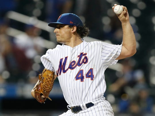 New York Mets starting pitcher Jason Vargas winds up during the sixth inning of the team's game against the San Francisco Giants, Wednesday, June 5, 2019, in New York.