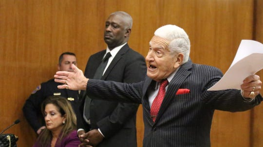 Here, Frank Lucianna defends his client during a trial.