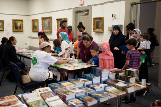 The Paterson Free Public Library offers free books to students during the annual 50-Book Club celebration to recognize Paterson students who read 50 books during the school year on Thursday, June 6, 2019.