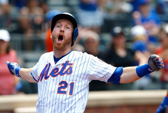 Jun 6, 2019; New York City, NY, USA;   New York Mets third baseman Todd Frazier (21) celebrates after hitting a home run against the San Francisco Giants in the eighth inning at Citi Field. Mandatory Credit: Noah K. Murray-USA TODAY Sports