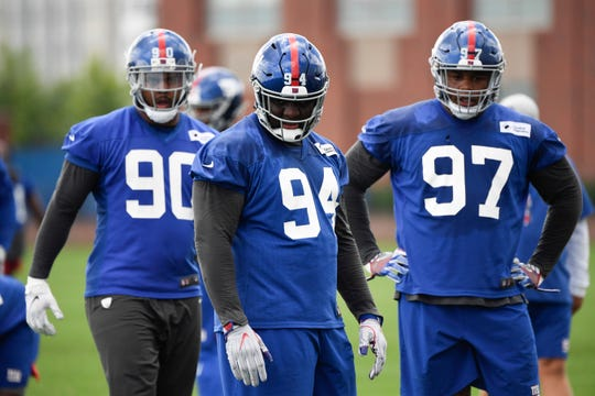 New York Giants defensive linemen R.J. McIntosh (90), Dalvin Tomlinson (94), and Dexter Lawrence (97) on Day 3 of Giants minicamp on Thursday, June 6, 2019, in East Rutherford.