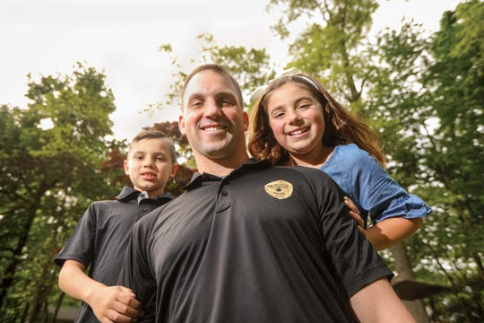 Mahwah police detective Eric Larsen with his kids Gabriella and Dean.