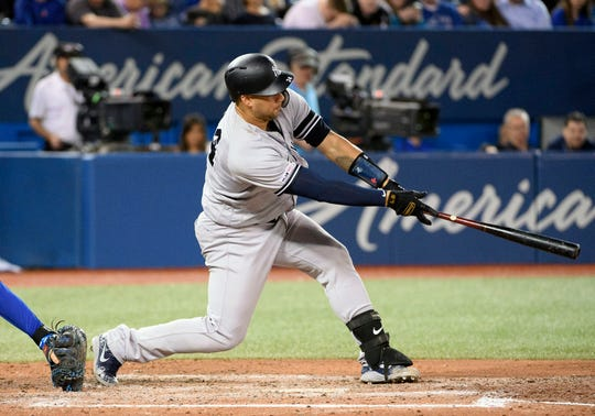 New York Yankees catcher Gary Sanchez (24) hits an RBI single against the Toronto Blue Jays during the fifth inning at Rogers Centre. Sports