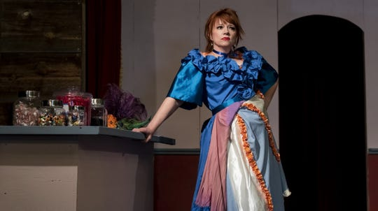 "The adventuring accountant from New Orleans, Coco LeBonBon (played by Heather Castello) tries to save her sister's candy store in Pinos Altos in Virus Theater's ""The Candy Shoppe Calamity, or The Good, The Bad, & The Pretty: A Bawdy Melodrama of Deceit, Decay, & Just Desserts."""