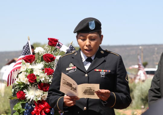 A great-granddaughter of Navajo Code Talker William Tully Brown Sr. reads a poem during the June 6 memorial service at the Fort Defiance Veterans Cemetery in Fort Defiance, Ariz.