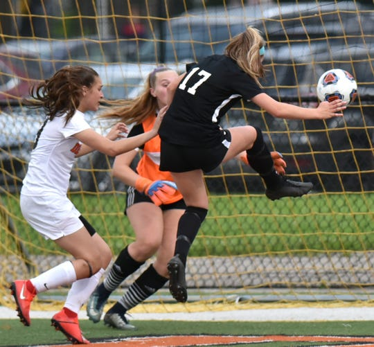 Plymouth Wildcat Brianna McNab (#17) booted in this ball just meters from Dearborn's goal for the first point of the game and its game-winner.