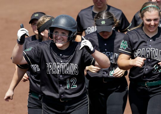 Oshkosh North's Brie Gauthier (12) celebrates after hitting a home run against Nicolet during a WIAA Division 1 state quarterfinal Thursday at Goodman Softball Complex in Madison.