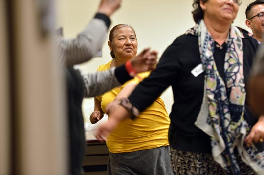 Gloria Huerta joins others as they exercise during a diabetes preventive group meeting at the UCI Health Family Health Center in Santa Ana, CA, on Tuesday, May 7, 2019. (Photo by Jeff Gritchen, Orange County Register/SCNG)