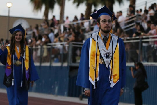 Cathedral City High School valedictorian Damien Bounds walks Wednesday during graduation ceremonies for the Class of 2019. The graduation was held outside at Cathedral City High's stadium.
