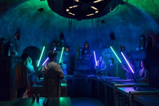 At Savi's Workshop in Star Wars: Galaxy's Edge, guests will have the opportunity to customize and craft their own lightsabers. Galaxy's Edge opened at Disneyland in Anaheim, Calif., on May 31, 2019. It is set to open on Aug. 29, 2019, at Disney's Hollywood Studios in Orlando, Fla.