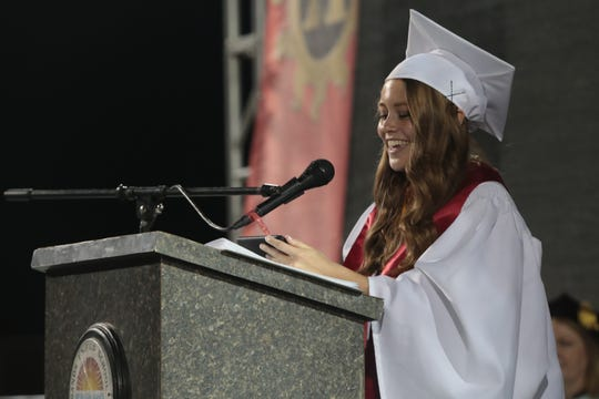 Aubrey Risenmay delivers the valedictory speech at the Palm Desert High School commencement ceremony, Palm Desert, Calif., June 5, 2019.