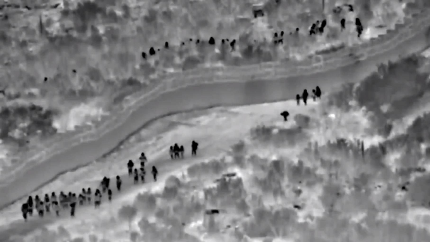 Video shows more than 130 migrants walking around border wall, then entering Arizona