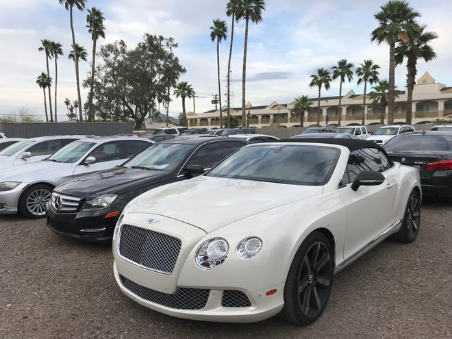 An Arizona used car dealer whodidn't pay off trades or transfer title to buyers said last year that if he wereripping off customers,he would be behind bars.  Farhad Kankash, owner of Onyx Motorsports in Tempe, was arrested and charged with 14 counts of fraud and theft.